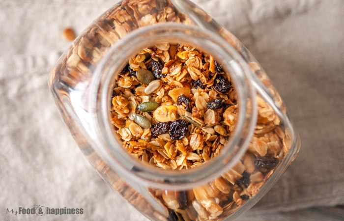 Simple Maple granola recipe with sunflower and pumpkin seeds and almond flakes and fruits. Sugar-free granola.