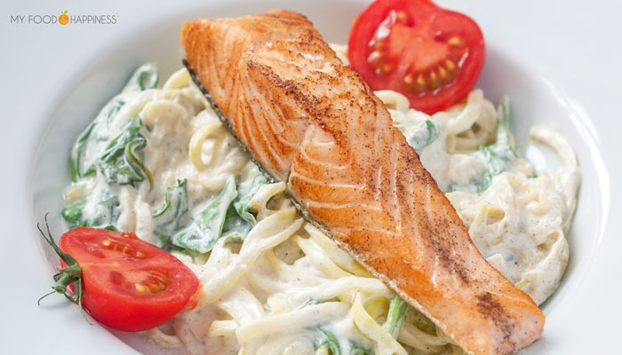 Healthy and delicious creamy spinach zoodles/courgetti with salmon. High-protein, low-carb and gluten-free pescatarian meal ready in just 15 minutes!