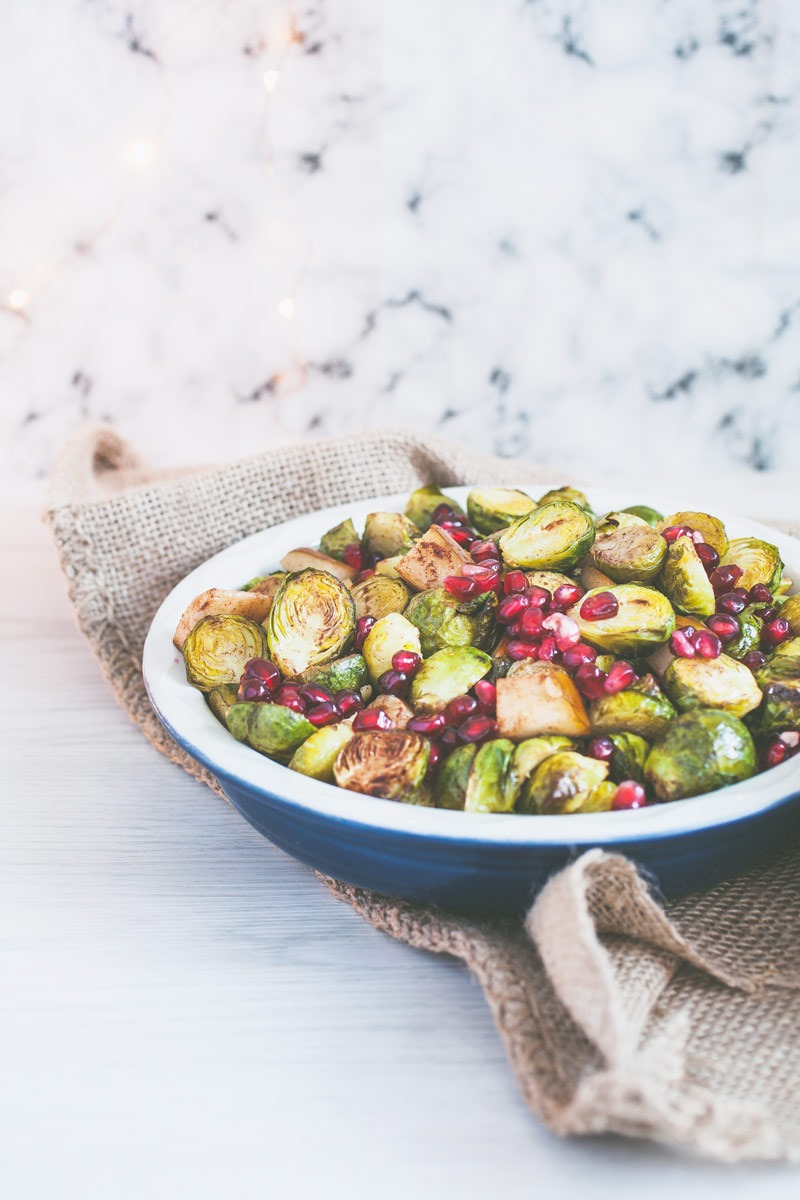 Spice up the traditional Christmas side, make these unconventional Cinnamon roasted Brussel sprouts with Pomegranate! Delicious Brussel sprouts, caramelised in honey and accompanied by warm pear and fresh pomegranate.
